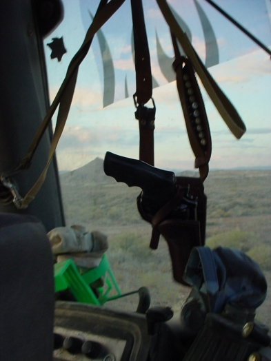 Gun in Backhoe